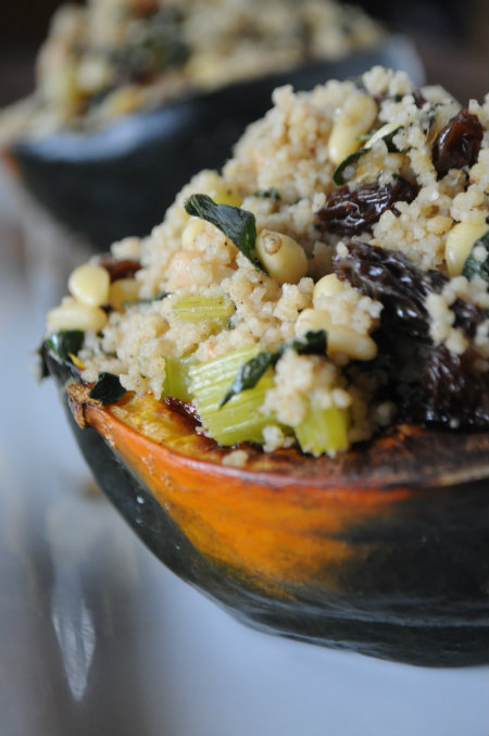 Whole Wheat Couscous Stuffed Acorn Squash with Kale, Raisins, and Pine Nuts